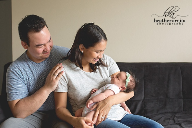 central ohio newborn photographer mom and dad looking down on baby2 web