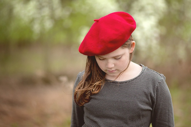 girl with red baret looking down - columbus ohio