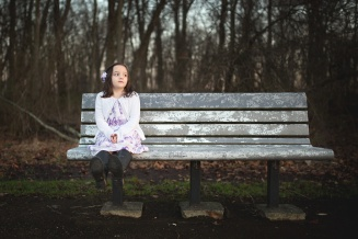girl on a park bench in columbus ohio