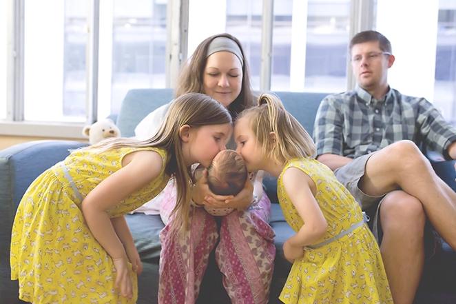 siblings meeting new baby hospital