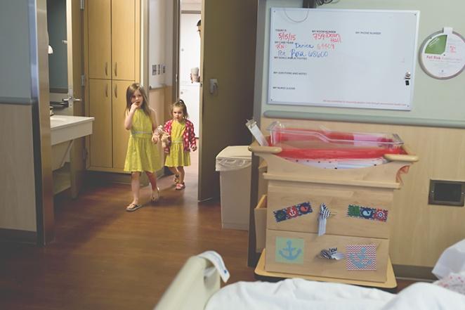 siblings meet new baby hospital