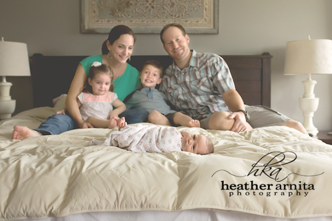 family lifestyle session master bed