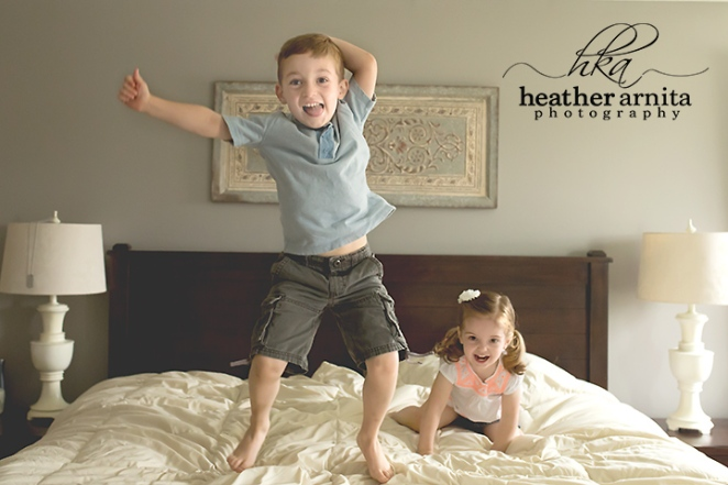 family lifestyle session kids jumping on bed
