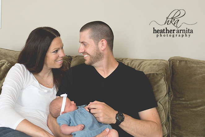 family lifestyle session lewis center ohio mom and dad smiling with baby
