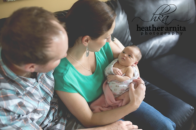 family lifestyle session mom dad with baby