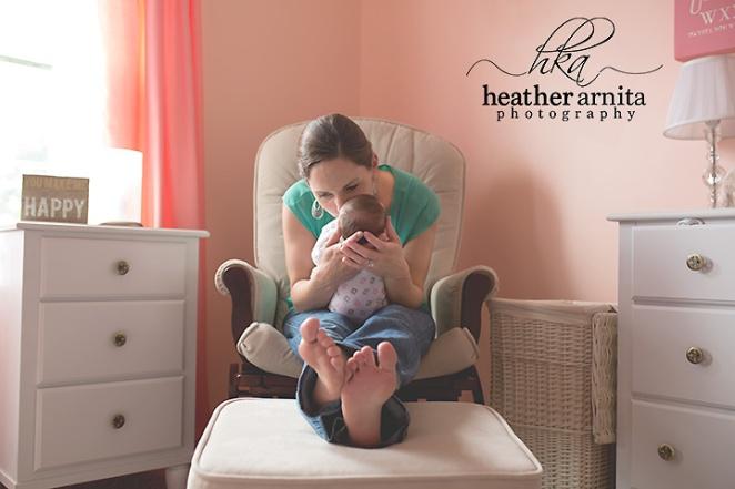 newborn with mom in nursery