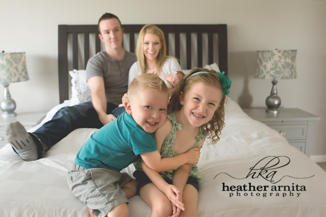 family lifestyle session kids laughing on bed