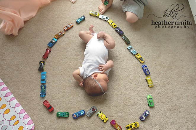 newborn lifetyle session in columbus ohio baby inside heart shape made of cars