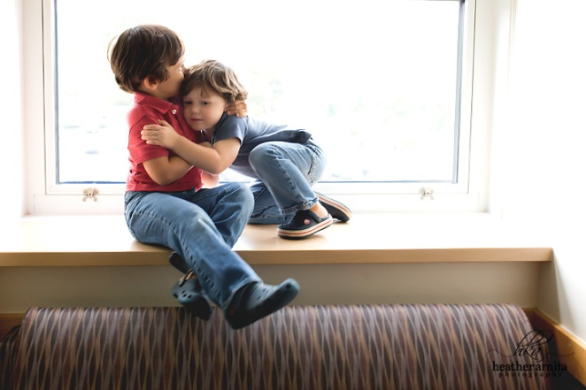 Heather Arnita Photography Fresh 48 session big brothers hugging on window sill