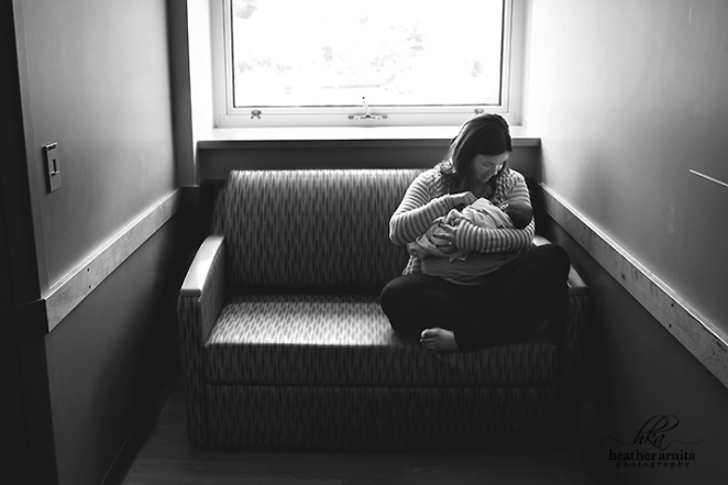 Heather Arnita Photography Fresh 48 session mom holding baby on couch dramatic black and white